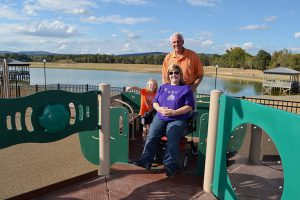 GMC Project Architect Mike Hamrick with Michele Miller, Ms. Wheelchair Alabama 2012, on the boundless playground.
